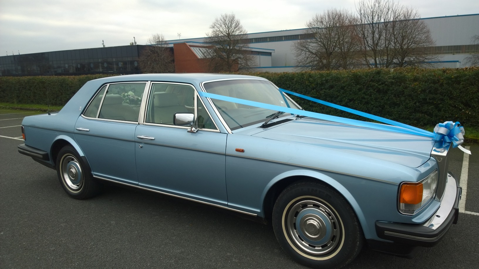 Blue Rolls Royce Silver Spirit with Wedding Ribbon