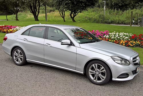 Silver E Class Mercedes outdoors