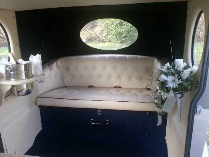 Wedding Car Interior Decorated with Champagne and Flowers