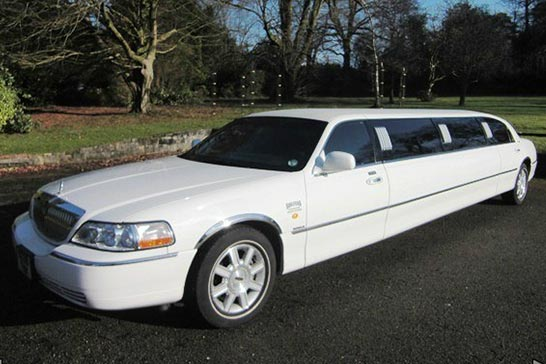 White Lincoln Towncar stretched limousine