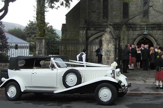 Beauford Open Top Wedding Car outside church